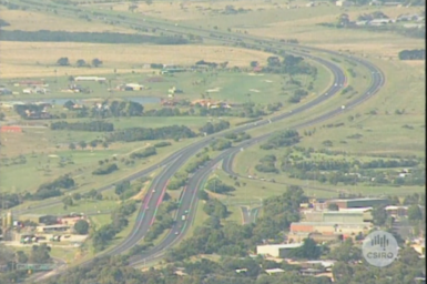 High angle view of freeway through rural landscape.