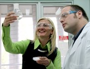 Larissa Bright and Dr Mark York in the lab with a flask of UV filters