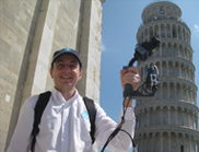 Person holding scanner in front of the Leaning Tower of Pisa