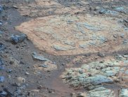 Opportunity's view (in false-colour) of ancient mudstones on a rocky outcrop on the rim of Endeavour Crater. Chemical analysis showed that around four billion years ago this would have been the oldest, most liveable mud on Mars, containing near-fresh water. (Image: NASA/JPL/Cornell/ASU)