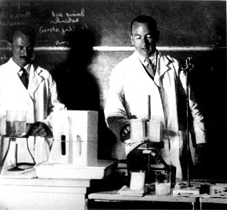 Bruce Fraser and Gordon Lennox engaged in a laboratory demonstration