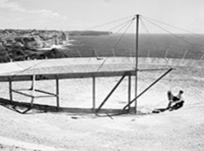 Construction work in February 1953 on the upgraded hole-in-the-ground antenna. South and North Head of Sydney Harbour can be seen in the background
