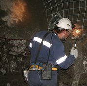 Rob Jeffrey examining a hydraulic fracture after its exposure by mining