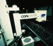 The Coalscan Dual Energy gamma-ray Transmission (DET) gauge over a conveyor belt