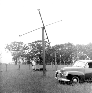 Dr Paul Wild with one of the position interferometer rhombic aerials erected at Dapto