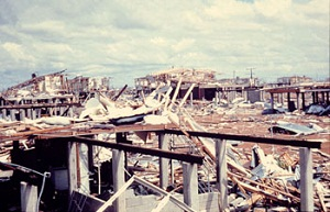 Inspecting the damage by Cyclone Tracy from the ground