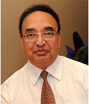 Sukhvinder Badwal wearing a shirt and tie