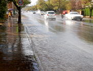 Stormwater flooding on a urban street.