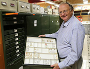 Dr Ted Edwards holding a tray of moth specimens from the ANIC.