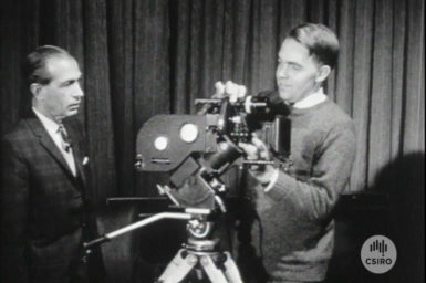 Two men with a film camera