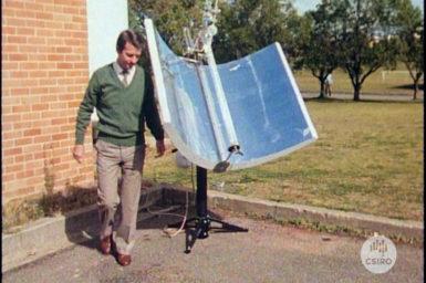 A man walks around a solar receptor.