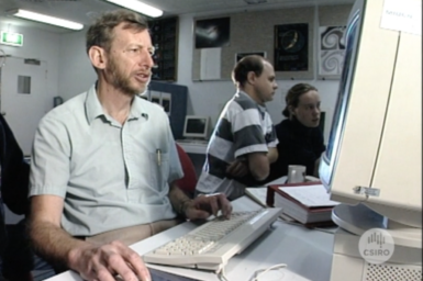 Dr Dick Manchester seated at computer.