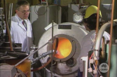 Dr Malcolm Frost and technician with lab scale furnace.