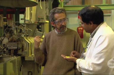 Ezio Rizzardo and colleague in laboratory.