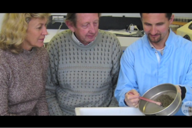 Dr Jenny Stauber, Dr Graeme Batleyand Dr Stuart Simpson inspecting sediment sample..