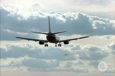 Commercial aircraft coming in for landing at airport.