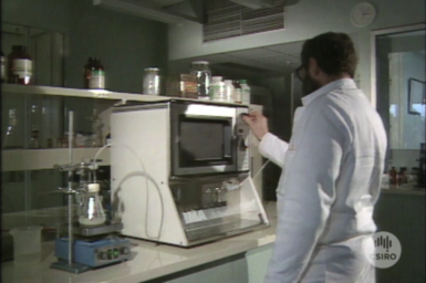 Dr Chris Strauss operating MicroLab unit in laboratory.