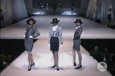 Woolen garments on display in fashion show.