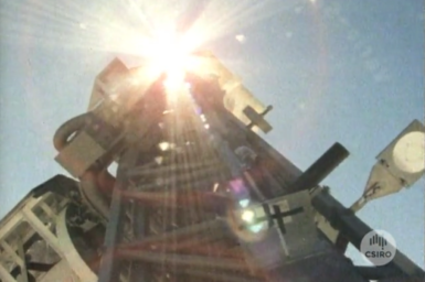 Optical telescope being aligned for solar observations.