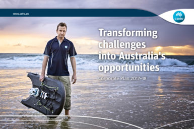 Cover of the Corporate Plan 2017-18 showing a man walking along the beach carry scientific equipment with the words 'Transforming challenges into Australia's opportunities. Corporate Plan 2017-18.'