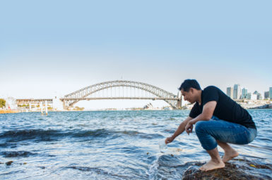 Scientist collecting water at Sydney Harbour.