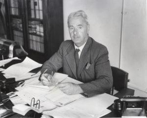 Bertram Thomas (Bert) Dickson [1886–1982] at desk.