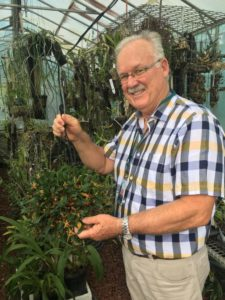 Dr Mark Clements standing in a greenhouse